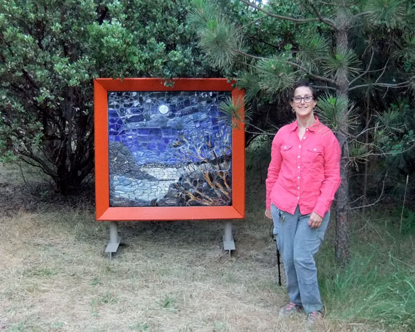 Artist Alicia Lee Farnsworth next  to her Handmade Mosaic Landscape paying homage to the full moon over Clear Lake in Lake County California for 2013's EcoArts Sculpture Walk