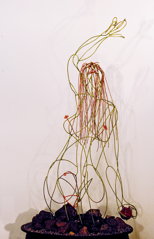 Persephone Emerging by Alicia Lee Farnsworth Painted steel wire figure emerging from Lava rocks. Photo by Herb Lingl for www.arportmuse.com