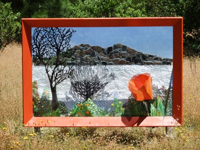 Artist, Alicia Farnsworth created this Steel Landscape Diarama of Clearlake with Mosaic Mt. Konocti freestanding with a large wood frame. It is nstalled from June through October at the Middletown  County Park as part of Lake County EcoArts 2010 sculpture walk.